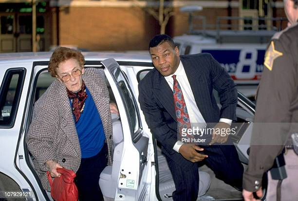 Mike Tyson with surrogate mother Camille Ewald arriving at City-County Building courthouse for trial regarding rape charges.Indianapolis, IN...