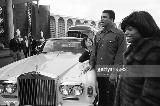 Heavyweight Boxing Muhammad Ali and celebrity singer Diana Ross next to RollsRoyce before fight vs Joe Bugner outside of Caesars Palace Las Vegas NV...