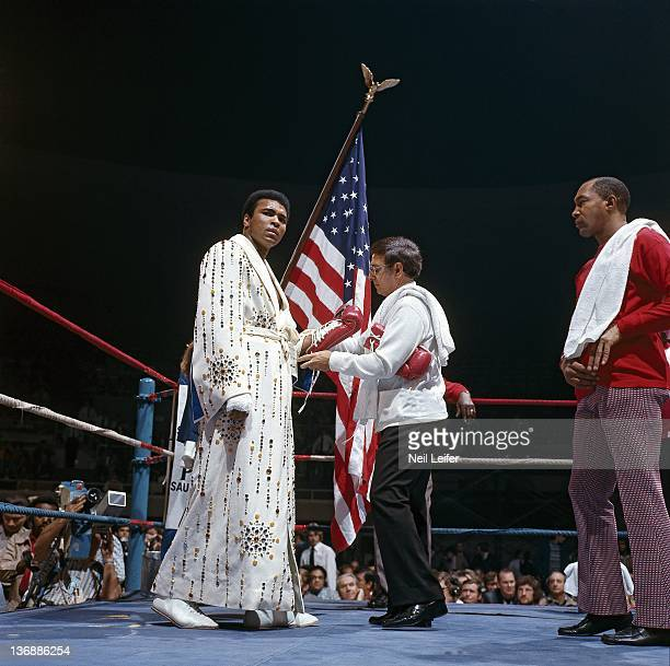Heavyweight Boxing Muhammad Ali getting glove laces tied by trainer Angelo Dundee before fight vs Joe Bugner at Las Vegas Convention Center View of...