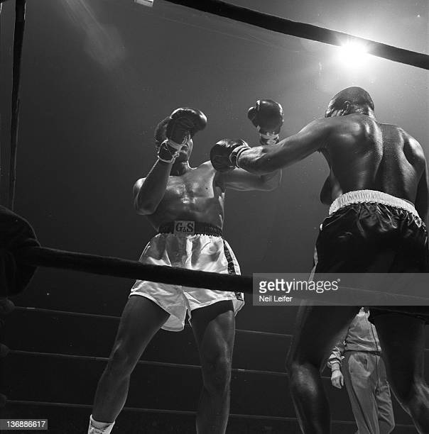 Heavyweight Boxing Muhammad Ali in action taking jab from Doug Jones during fight at Madison Square Garden New York NY 3/13/1963 CREDIT Neil Leifer