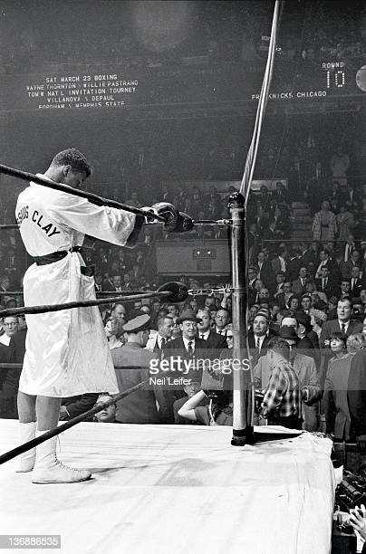 Heavyweight Boxing Muhammad Ali praying in corner of ring before first bell of fight vs Doug Jones at Madison Square Garden New York NY 3/13/1963...