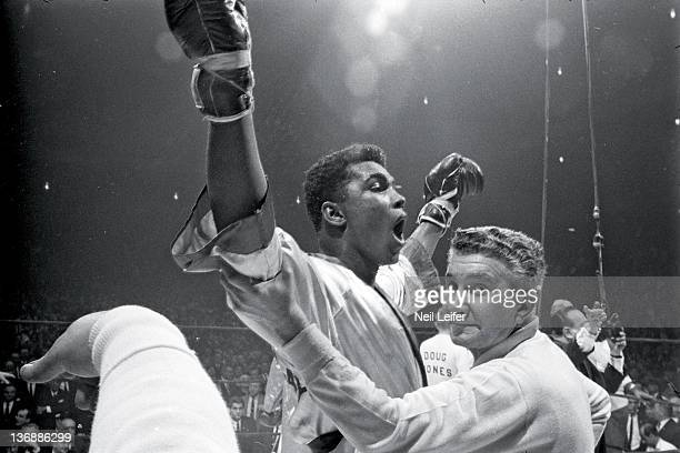 Heavyweight Boxing Muhammad Ali victorious with his corner cut man Chickie Ferrara after winning fight vs Doug Jones at Madison Square Garden New...