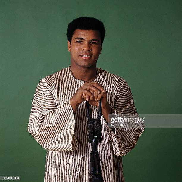 Heavyweight Boxing Sportsman of the Year Casual portrait of Muhammad Ali wearing dashiki during photo shoot at Playboy Studios Ali holding cane given...