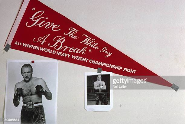 """View of photos and pennant of Chuck Wepner at his Granite Hotel training camp headquarters in the Catskill Mountains. Pennant says """"GIVE THE WHITE..."""