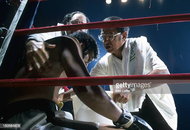 View of trainer Angelo Dundee in corner with Jimmy Ellis during fight vs Ron Lyle at Denver Coliseum Denver CO CREDIT Neil Leifer
