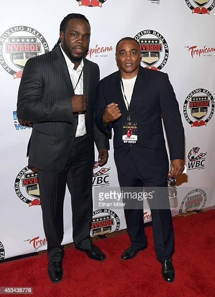 WBC heavyweight champion Bermane Stiverne recipient of a special achievement award and his trainer Don House arrive at the second annual Nevada...