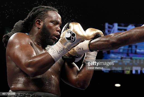 WBC heavyweight champion Bermane Stiverne takes a punch from Deontay Wilder during their title fight at the MGM Grand Garden Arena on January 17 2015...