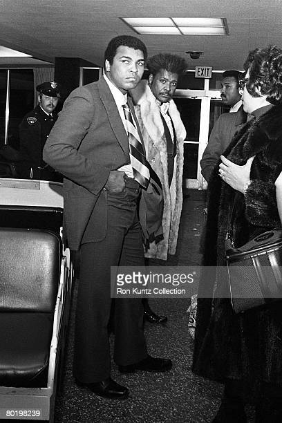 Heavyweight champion boxer Muhammad Ali and promoter Don King arrive in town on February 10, 1975 in Cleveland, Ohio to begin training for his...