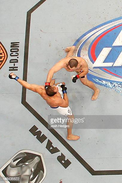 UFC heavyweight champion Cain Velasquez and Junior Dos Santos exchange punches in their UFC heavyweight championship bout at the Toyota Center on...