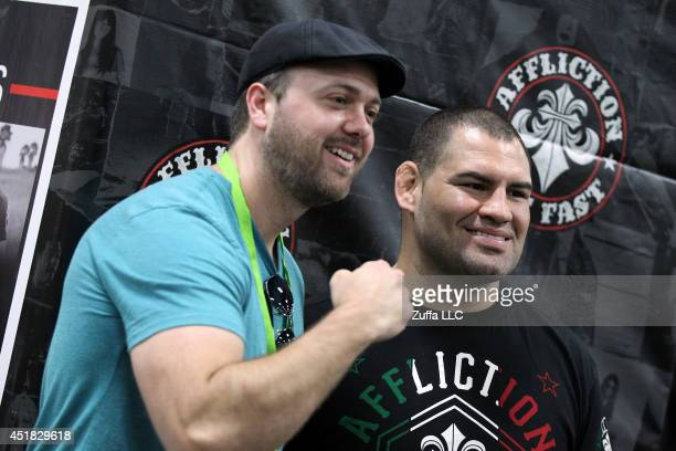 UFC heavyweight champion Cain Velasquez poses with a fan during the UFC Fan Expo 2014 during UFC International Fight Week at the Mandalay Bay...