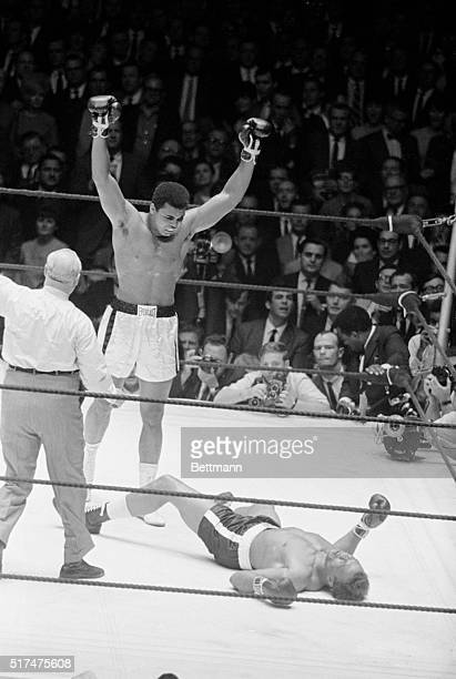 Heavyweight champion Cassius Clay raises his arms in a victory gesture after flattening challenger Cleveland Williams in second round of title fight...