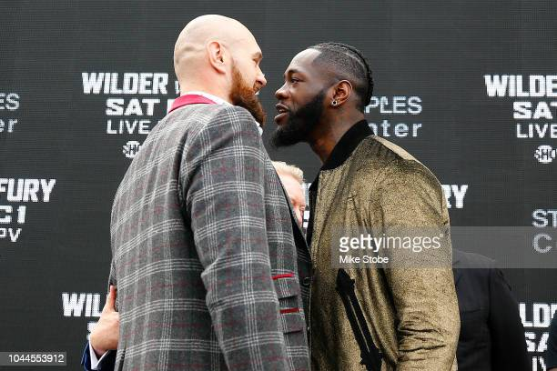 Heavyweight champion Deontay Wilder and Lineal Heavyweight champion Tyson Fury faceoff during the New York Press Conference at Intrepid SeaAirSpace...