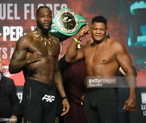 WBC heavyweight champion Deontay Wilder and Luis Ortiz pose during their official weighin at MGM Grand Garden Arena on November 22 2019 in Las Vegas...