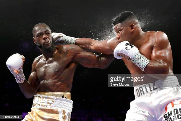 WBC heavyweight champion Deontay Wilder and Luis Ortiz trade punches during their title fight at MGM Grand Garden Arena on November 23 2019 in Las...