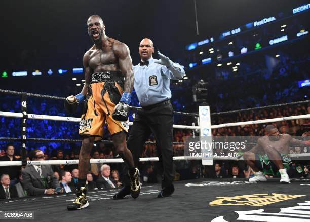 TOPSHOT WBC heavyweight champion Deontay Wilder celebrates knocking down undefeated contender Luis King Kong Ortiz during their 12round WBC...