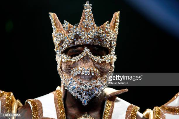 WBC heavyweight champion Deontay Wilder enters the ring for the start of his title fight against Luis Ortiz at MGM Grand Garden Arena on November 23...