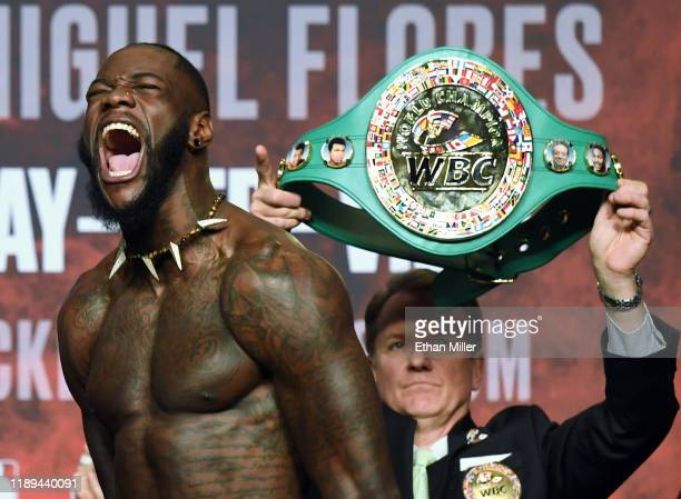 "Heavyweight champion Deontay Wilder makes his signature ""bomb squad"" yell during his official weigh-in at MGM Grand Garden Arena on November 22, 2019..."