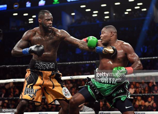 Heavyweight champion Deontay Wilder of the US fights contender Luis Ortiz of Cuba during their WBC heavyweight title fight in New York on March 3...