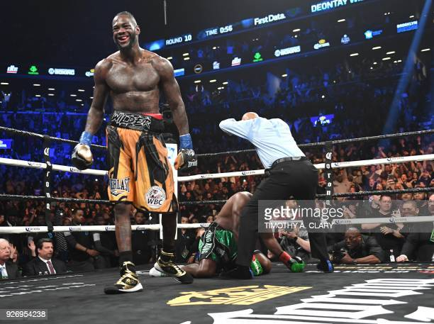 Heavyweight champion Deontay Wilder of the US knocks down undefeated contender Luis King Kong Ortiz in the 10th round, during their 12-round WBC...