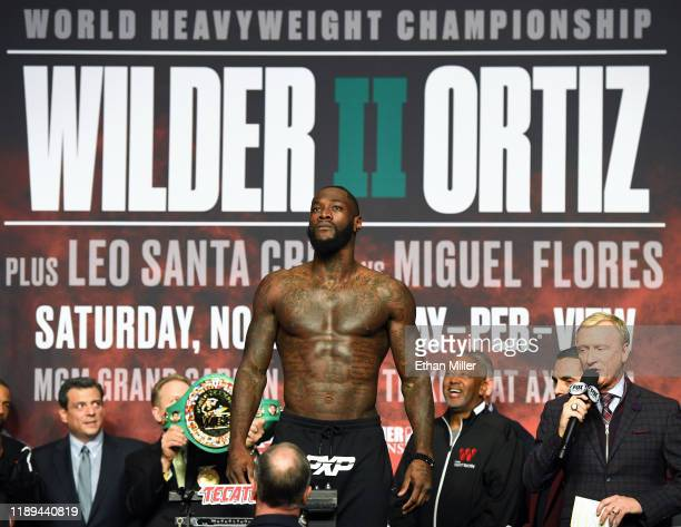 WBC heavyweight champion Deontay Wilder poses on the scale during his official weighin at MGM Grand Garden Arena on November 22 2019 in Las Vegas...