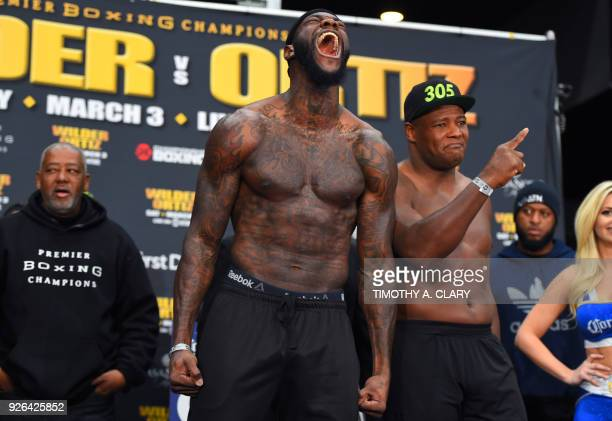 WBC heavyweight champion Deontay Wilder screams next to undefeated contender Luis King Kong Ortiz during the official weighin at Barclays Center...