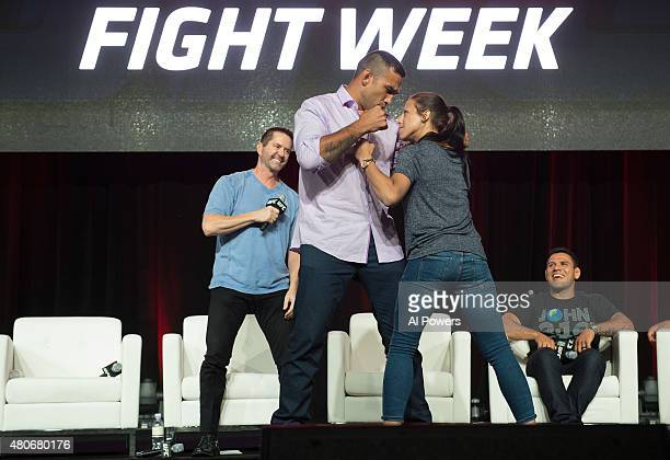 UFC heavyweight champion Fabricio Werdum and women's strawweight champion Joanna Jedrzejczyk face off at the UFC Fan Expo in the Sands Expo and...