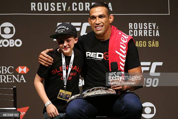 Heavyweight Champion Fabricio Werdum of Brazil interacts with a fan during a Q&A session before the UFC 190 Rousey v Correia weigh-in at HSBC Arena...