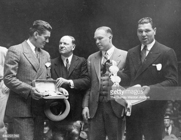 Heavyweight Champion Gene Tunney and the man he won the title from Jack Dempsey receive their Championship Belts from the Boxers Writer's Association...