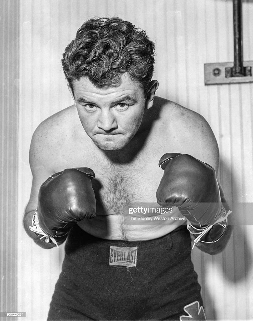 Heavyweight Champion Jim Braddock strikes his fighting pose at his traning camp while preparing for his fight against Joe Louis, at the hotel Golfmore on June 18, 1937 in Grand Beach, Michigan.