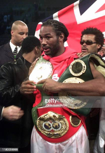 WBC/IBF heavyweight champion Lennox Lewis from England holds his belts after defeating Samoanborn David Tua from New Zealand at Mandalay Bay Casino...