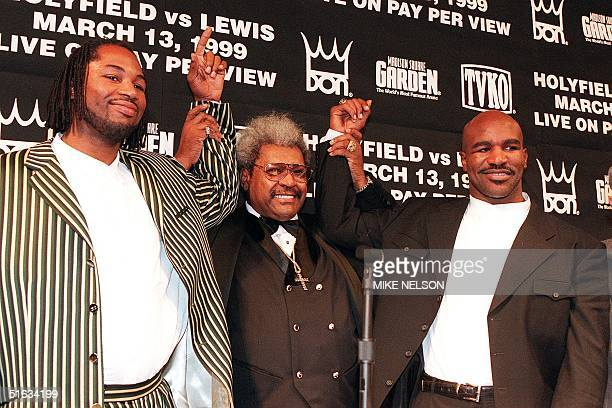 WBC heavyweight champion Lennox Lewis from Great Britain and WBA and IBF heavyweight champion Evander Holyfield from the US pose with boxing promoter...