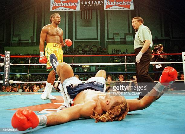 Heavyweight champion Lennox Lewis of Britain walks to his corner after knocking down Shannon Briggs of the United States during the fifth round of...