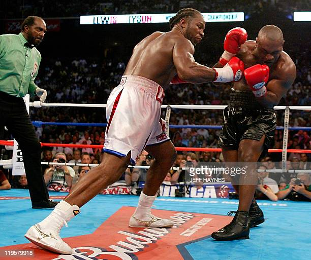 Heavyweight Champion Lennox Lewis of Britian lands a right uppercut to Mike Tyson of the US during their World Heavyweight Championship fight as...