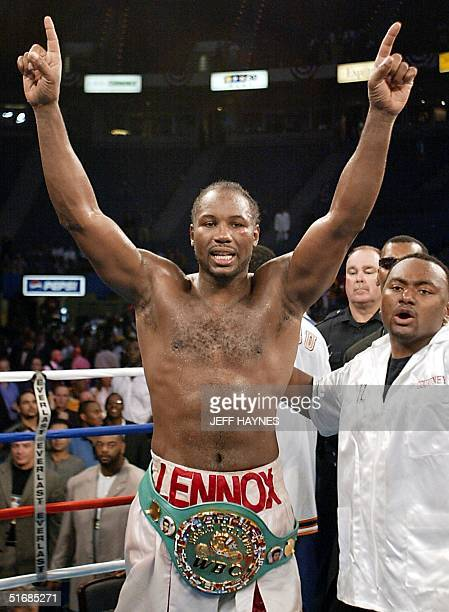 Heavyweight Champion Lennox Lewis of England raises his arms in victory after beating challenger Mike Tyson in a knockout in the eighth round during...