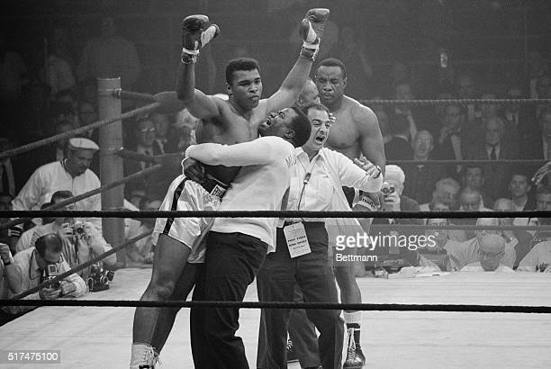 Heavyweight champion Muhammad Ali is lifted in jubilation after his match with boxer Sonny Liston Clay knocked out Liston in the first round of the...