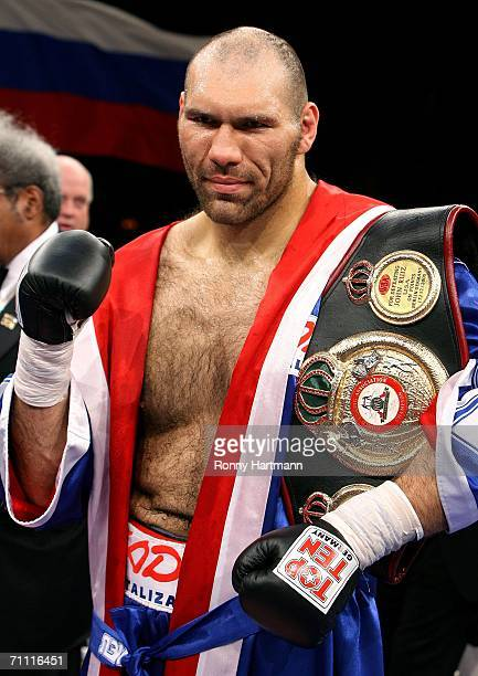 WBA heavyweight champion Nikolai Valuev of Russia holds his trophy after defeating Owen Beck of Jamaica at the Tui Arena on June 3 2006 in Hanover...