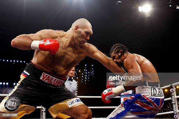 WBA heavyweight champion Nikolai Valuev of Russia lands a left before being defeated by David Haye of Britain in their WBA heavyweight championship...