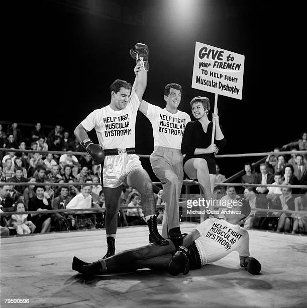 Heavyweight champion of the world Rocky Marciano defeats Jerry Lewis in a mock boxing match to aid Muscular Dystrophy on November 18 1954 in Los...