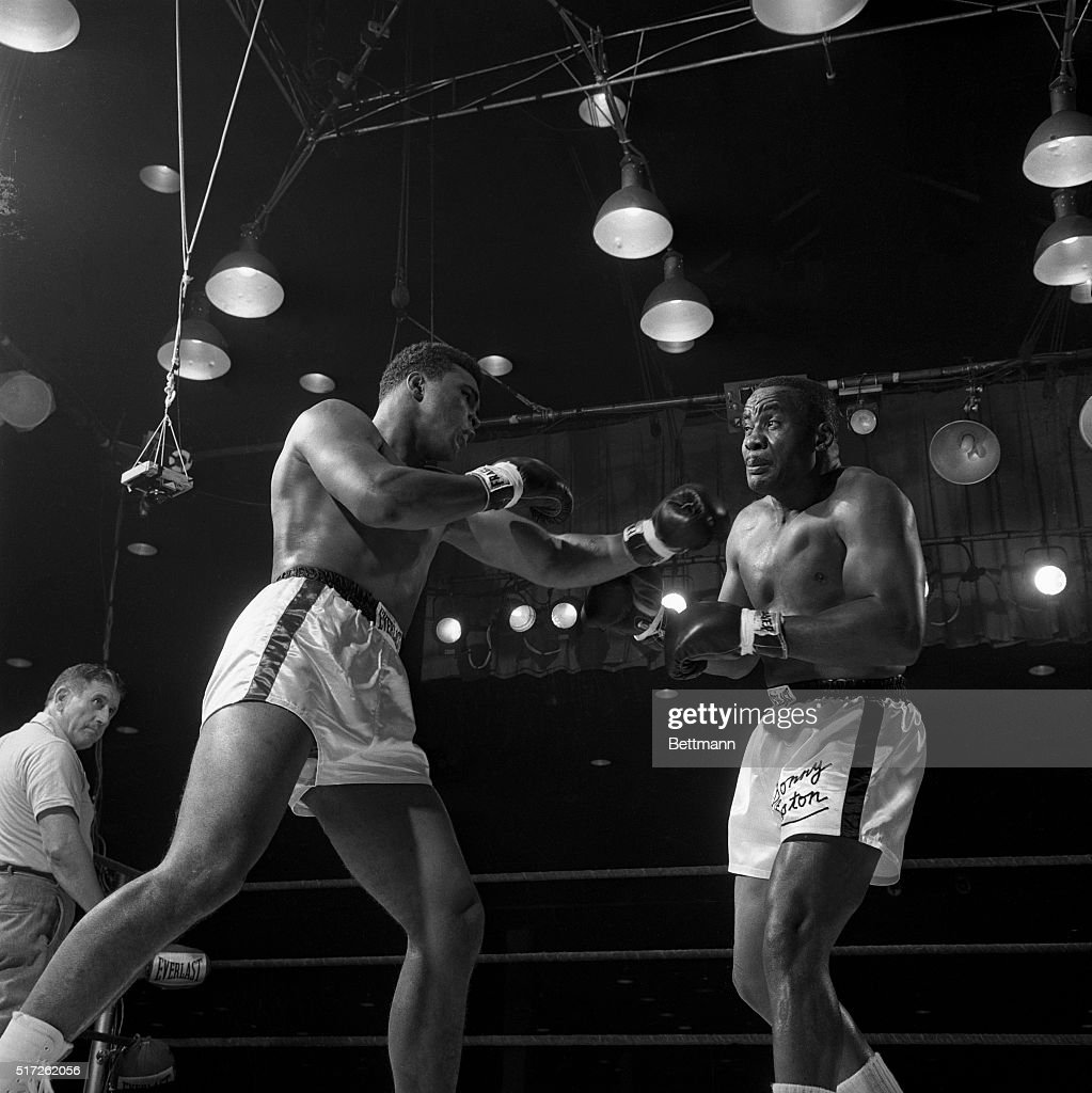 Heavyweight champion Sonny Liston grimaces as Cassius Clay (later known as Muhammad Ali) shakes him up with a left in the 6th round of their 1964 title fight. Clay beat Liston on the 7th round by knocking him out.