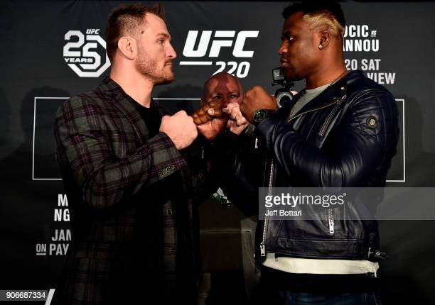 UFC heavyweight champion Stipe Miocic and Francis Ngannou of Cameroon face off during the UFC 220 Ultimate Media Day at Fenway Park on January 18...