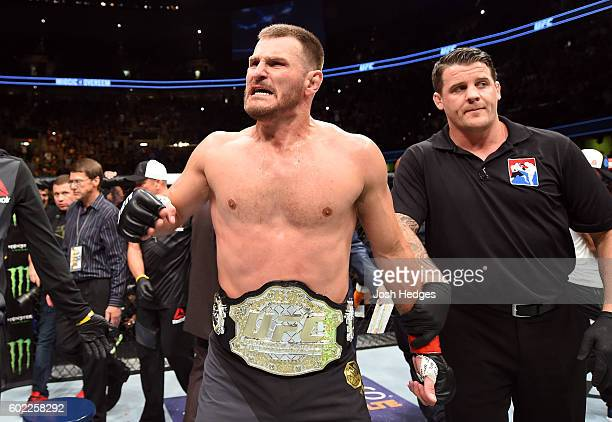UFC heavyweight champion Stipe Miocic celebrates after defeating Alistair Overeem of The Netherlands in their UFC heavyweight championship bout...