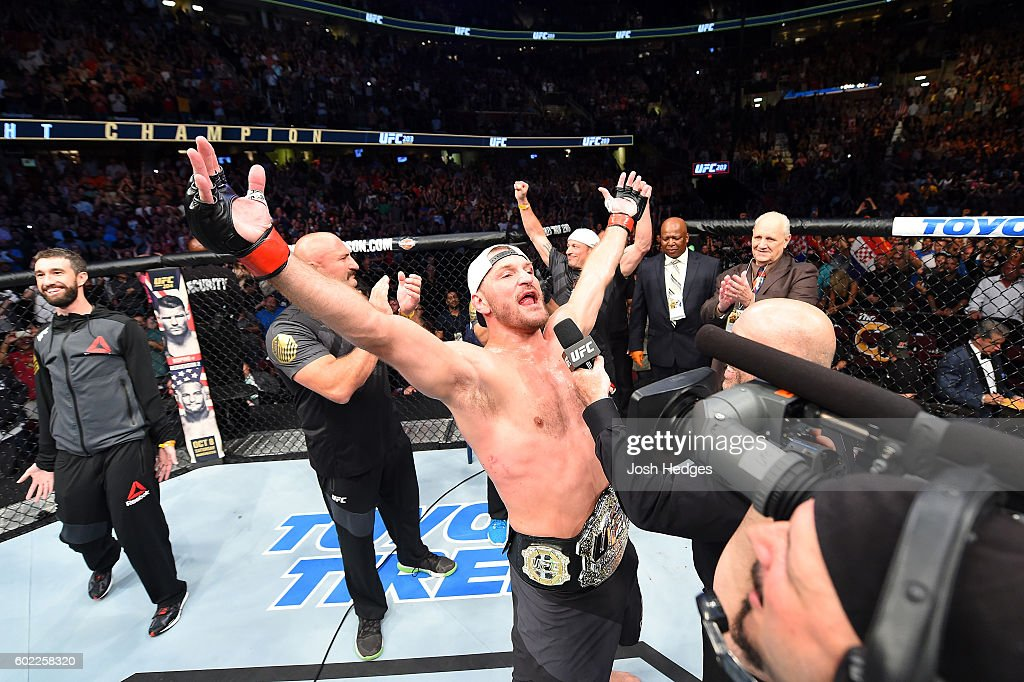 UFC heavyweight champion Stipe Miocic celebrates after defeating Alistair Overeem of The Netherlands in their UFC heavyweight championship bout during the UFC 203 event at Quicken Loans Arena on September 10, 2016 in Cleveland, Ohio.
