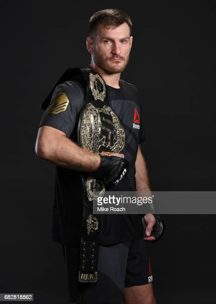 UFC heavyweight champion Stipe Miocic poses for a post fight portrait backstage during the UFC 211 event at the American Airlines Center on May 13...