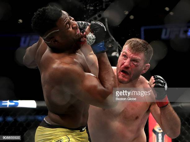 UFC heavyweight champion Stipe Miocic right lands a punch in his defeat of No 1 challenger Francis Ngannou to retain his championship belt in the...