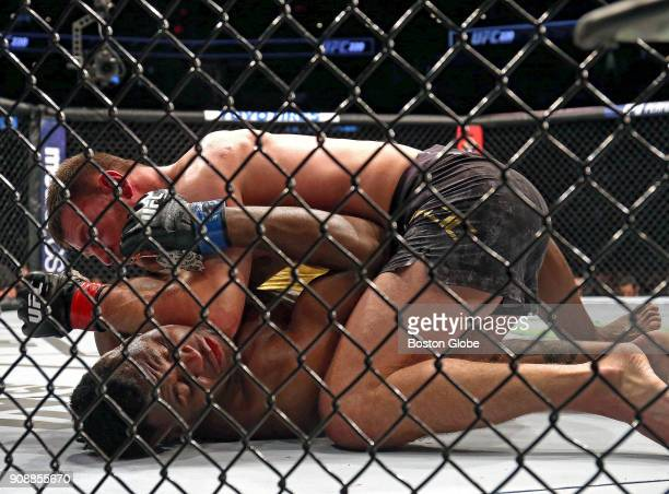 UFC heavyweight champion Stipe Miocic top defeats No 1 challenger Francis Ngannou to retain his championship belt in the main event during UFC 220 at...