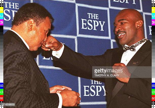 Heavyweight Champions Muhammad Ali and Evander Holyfield play around for the cameras after recieving their ESPY Awards at the 5th Annual ceremony at...