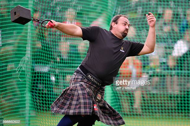 A heavyweight competitor takes part at the Braemar Gathering on September 3 2016 in Braemar Scotland There has been an annual gathering at Braemar in...