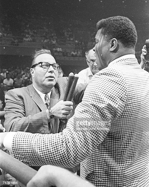 Heavyweight contender Cassius Clay attempts to get to the ring to taunt Sonny Liston who has just defeated former champion Floyd Patterson to retain...