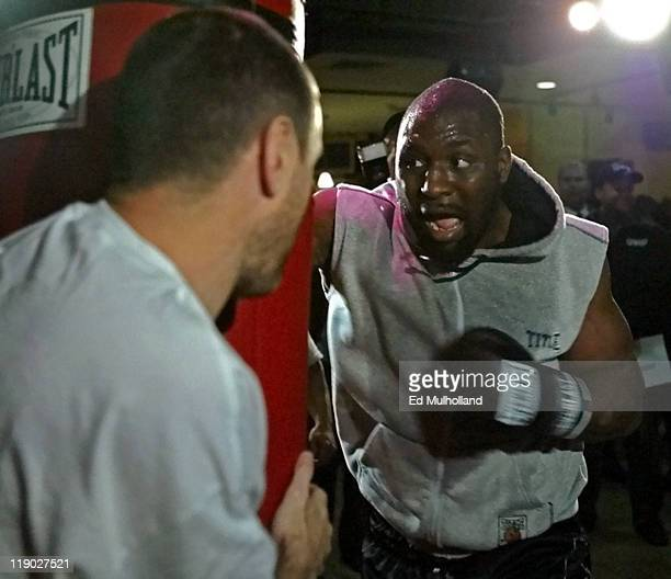 Heavyweight Contender Danny Williams hits the heavy bag during a workout for his upcoming WBC Heavyweight Championship fight against Vitali Klitschko...