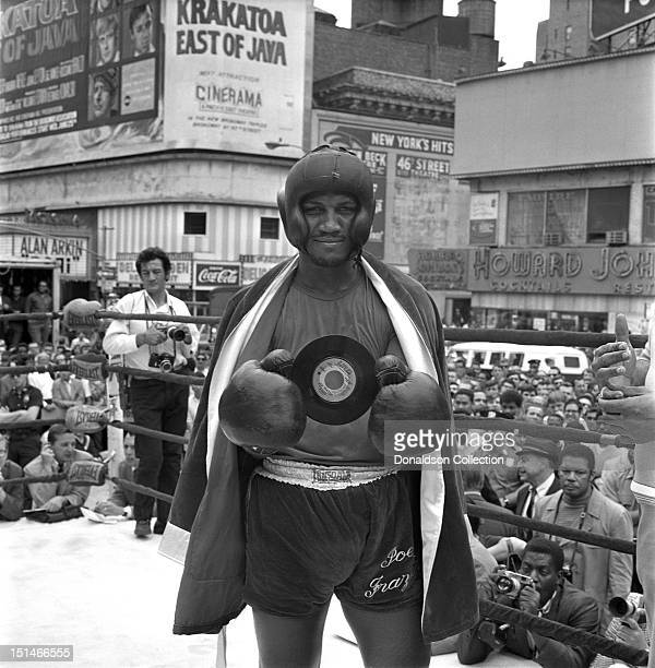 Heavyweight contender Joe Frazier poses with his latest single 'If You go Stay Gone' while preparing for his fight against Jerry Quarry on June 16...